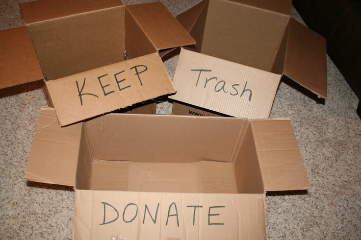 keep trash donate pile boxes